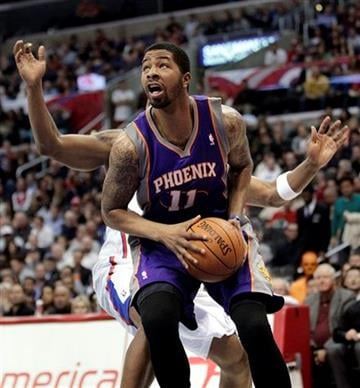 Phoenix Suns' Markieff Morris looks to shoot in front of Los Angeles Clippers' Bobby Simmons during the first half of an NBA basketball game in Los Angeles, Thursday, March 15, 2012. (AP Photo/Jae C. Hong) By Jae C. Hong