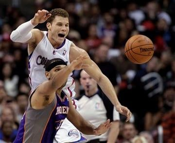 Los Angeles Clippers' Blake Griffin, top, and Phoenix Suns' Jared Dudley go after a loose ball during the first half of an NBA basketball game in Los Angeles, Thursday, March 15, 2012. (AP Photo/Jae C. Hong) By Jae C. Hong