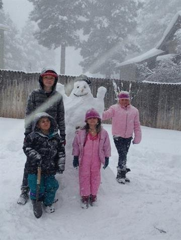 Summer Lilly said the kids are having a blast in the snow! Here's a picture of the snowman they made. By Mike Gertzman
