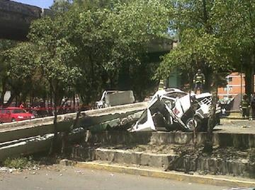 A pedestrian bridge fell on a bus during the quake but there were no injuries, according to officials By Mike Gertzman