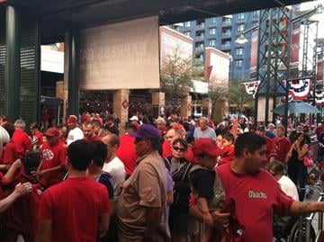 Fans make their way into Chase Field for Diamondbacks first regular season game By Mike Gertzman