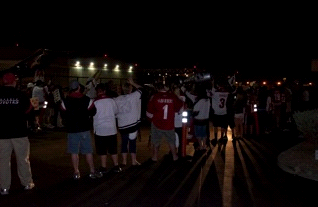 Fans father at Sky Harbor Aiport Saturday night to greet the Coyotes when they got home from Minnesota. By Mike Gertzman