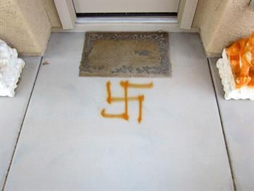 Vandals spray-painted symbols and phrases on sidewalks and the sides of homes in the Johnson Ranch subdivision. By Jennifer Thomas