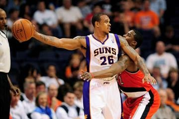 Phoenix Suns guard Shannon Brown (26) handles the ball against the Portland Trail Blazers guard Wesley Matthews (2) during the first half at the US Airways Center. By Catherine Holland