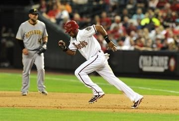 PHOENIX, AZ - APRIL 16:  Chris Young #24 of the Arizona Diamondbacks attempts to steal second base against the Pittsburgh Pirates at Chase Field on April 16, 2012 in Phoenix, Arizona.  (Photo by Norm Hall/Getty Images) By Norm Hall