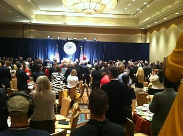 A standing ovation for Romney as he arrives for a campaign speech in Scottsdale By Mike Gertzman