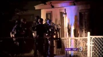 Police officers took about 10 people into custody at a Mesa drop house. By Jennifer Thomas