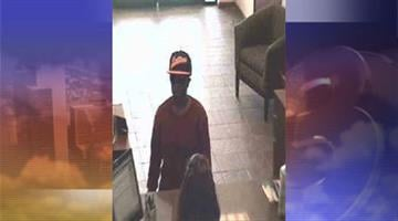 Surveillance photo of suspect who robbed a Great Western Bank in Maricopa By Jennifer Thomas