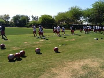 Arizona Cardinals' quarterback Kevin Kolb and more than sixty other players were on hand for the team's first voluntary workout this month. By Mike Gertzman