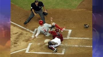 Hunter Pence #3 of the Philadelphia Phillies is tagged out at home plate by catcher Henry Blanco #12 of the Arizona Diamondbacks during the first inning of the MLB game at Chase Field on April 25, 2012 in Phoenix. By Jennifer Thomas