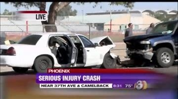 Police said the driver of a white car was trying to pass in a school zone near near 37th Avenue and Camelback Road and crashed head-on into a blue pickup truck. By Jennifer Thomas