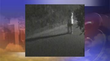 Police released surveillance video, which shows what appears to be a man who walked by Nancy Newton's home at about the time of the crime. By Jennifer Thomas