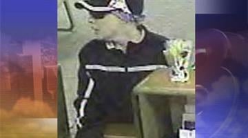 A Compass Bank in Mesa was reportedly robbed by the woman pictured on April 27. By Andrew Michalscheck