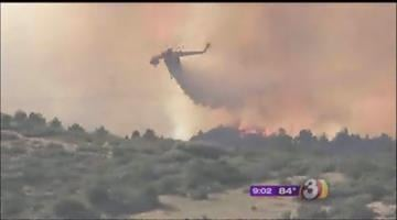 A helicopter drops water on the the Sunflower Fire By Mike Gertzman