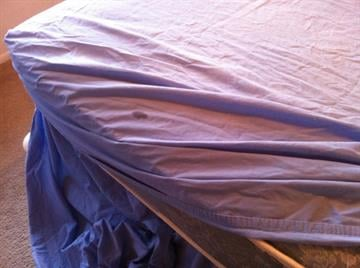 Stains on the sheets of one of beds By Mike Gertzman