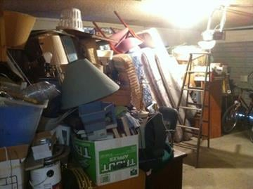 "Two-car garage packed with the homeowner's belongings. The home is advertised as having a ""two car garage with opener."" By Mike Gertzman"