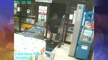 A black male in his late 20s is suspected in the robbery of a Gilbert Walgreens on May 31. By Andrew Michalscheck
