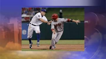 Arizona Diamondbacks Aaron Hill is tagged out by Texas Rangers second baseman Ian Kinsler. By Jennifer Thomas
