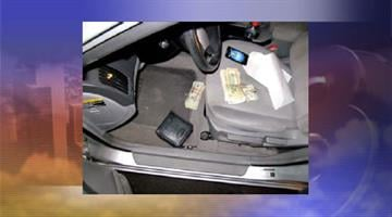 Currency found inside Kirk Hutchins' vehicle By Jennifer Thomas