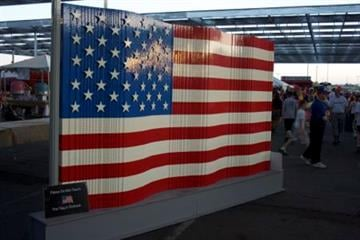 Sunrise on the US Flag at Pat's Run By Catherine Holland