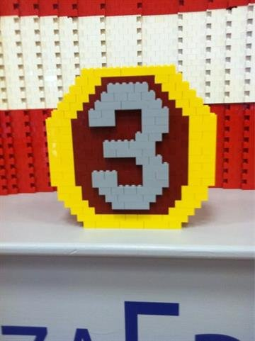 Reporter Tess Rafols used LEGO bricks to build the 3TV logo. By Catherine Holland