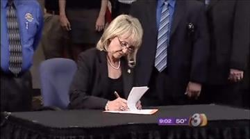 Gov. Jan Brewer sign SB 1070 into law on April 23, 2010. The measure has faced various legal challenges since. By Catherine Holland