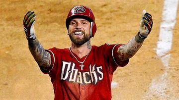 Arizona Diamondbacks' Ryan Roberts reacts after hitting an inside-the-park home run against the Seattle Mariners during the sixth inning of an interleague baseball game, Wednesday, June 20, 2012, in Phoenix.  (AP Photo/Matt York) By Matt York