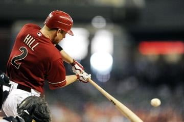 PHOENIX, AZ - JUNE 20:  Aaron Hill #2 of the Arizona Diamondbacks hits a home run against the Seattle Mariners at Chase Field on June 20, 2012 in Phoenix, Arizona.  (Photo by Norm Hall/Getty Images) By Norm Hall