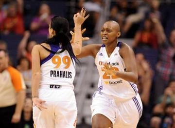 Phoenix Mercury guard Sammy Prahalis, left, is congratulated by teammate Charde Houston during their 80-77 win over the Washington Mystics. By Catherine Holland