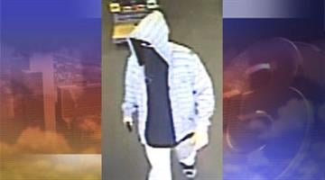 Surveillance photo of suspect police say has committed several armed robberies in the Phoenix area. By Jennifer Thomas