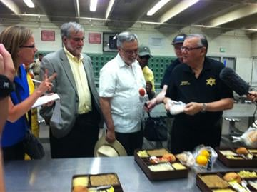 Sheriff Arpaio shows off meal options inside Tent City. By Mike Gertzman