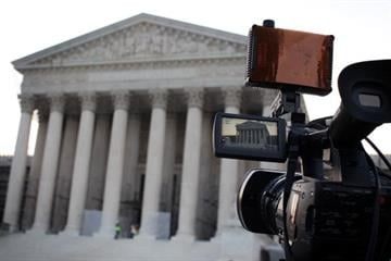 WASHINGTON, DC - JUNE 25:  A TV camera is set up in front of the U.S. Supreme Court June 25, 2012 in Washington, DC. The Supreme Court is expected to hand down its ruling on the Healthcare Reform Law soon.  (Photo by Alex Wong/Getty Images) By Alex Wong