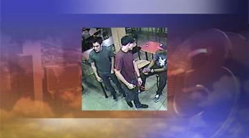 The suspect is wearing a dark gray T-shirt, blue jeans and sneakers in this photograph. By Jennifer Thomas