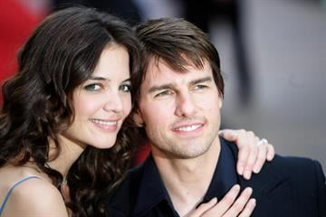 """LONDON - JUNE 19:  Actors Katie Holmes and fiance Tom Cruise arrive at the UK premiere of """"War Of The Worlds"""" at the Odeon Leicester Square June 19, 2005 in London, England.  (Photo by MJ Kim/Getty Images) By MJ Kim"""