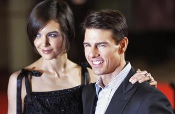 """US actor Tom Cruise (R) and wife Katie Holmes arrive for the UK premiere of the film """"Valkyrie"""" in London's Leicester Square, on January 21, 2009.    AFP PHOTO/ SHAUN CURRY (Photo credit should read SHAUN CURRY/AFP/Getty Images) By SHAUN CURRY"""