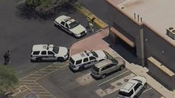 Police investigate a shooting at Deer Valley Towne Center in Phoenix. By Jennifer Thomas