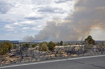 Seen from Highway 87, looking north, the Canyon Fire continues to burn mostly in pinyon, juniper and grassland. Photo taken July 2. By Jennifer Thomas