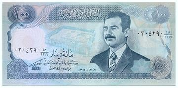 Old Iraqi dinar featured Saddam Hussein By Meredith Yeomans