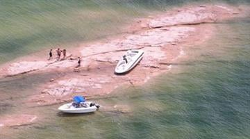 A woman and two children were ejected from a boat onto the shore. By Jennifer Thomas