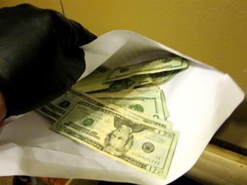 Cash seized inside a suspect's residence By Jennifer Thomas