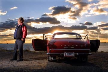 403008 12: Irv Gordon Stands Next To His 1966 Volvo P1800 In This Undated Photo. Gordon Was Honored For Driving The Car Two Million Miles.  (Photo By Getty Images) By Getty Images