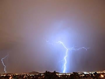 Noticed lots of lightning from inside, grabbed the camera and took some amazing shots. By Catherine Holland