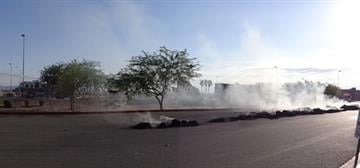 A tractor-trailer rig loaded with hay caught fire at Love's Travel Stop in Yuma. By Jennifer Thomas