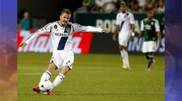 David Beckham #23 of the Los Angeles Galaxy celebrates scoring his first goal in the first half against the Portland Timbers on July 14, 2012, at Jeld-Wen Field in Portland, Ore. By Jennifer Thomas