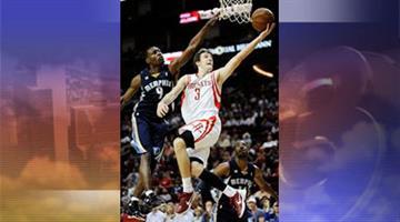 In this March 30, 2012, file photo, Houston Rockets' Goran Dragic shoots against Memphis Grizzles' Tony Allen. By Jennifer Thomas