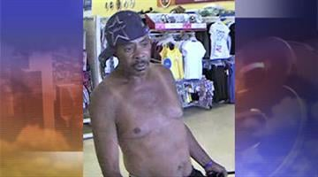 Surveillance photo of armed robbery suspect By Jennifer Thomas
