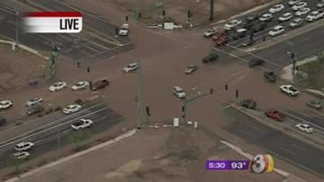 The intersection of 7th Street and Deer Valley Road was underwater during rush hour. By Mike Gertzman