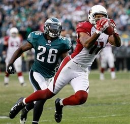 Arizona Cardinals' Larry Fitzgerald, right, pulls in a pass as Philadelphia Eagles' Jaiquawn Jarrett pursues in the second half of an NFL football game on Sunday, Nov. 13, 2011, in Philadelphia. (AP Photo/Mel Evans) By Mel Evans