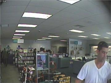 Male suspect in white V-neck shirt at the SuperPawn located at 2916 E. Route 66 in Flagstaff on June 19. By Jennifer Thomas