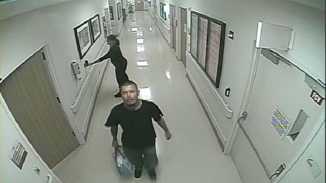 Surveillance video shows father taking baby from hospital.